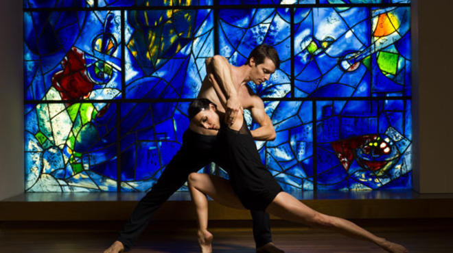 Hubbard  Street Dance Chicago's Anna Lopez and Garrett Anderson in front  of Marc Chagall's America Windows at the Art Institute of Chicago