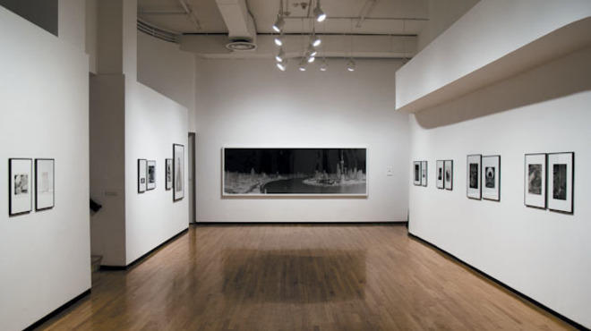 "Installation view of ""1979:1-2012:21: Jan TIchy Works with the MoCP Collection"" at the Museum of Contemporary Photography, 2012."