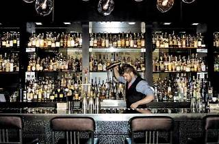 Sable Kitchen and Bar head bartender Mike Ryan shakes up a drink.