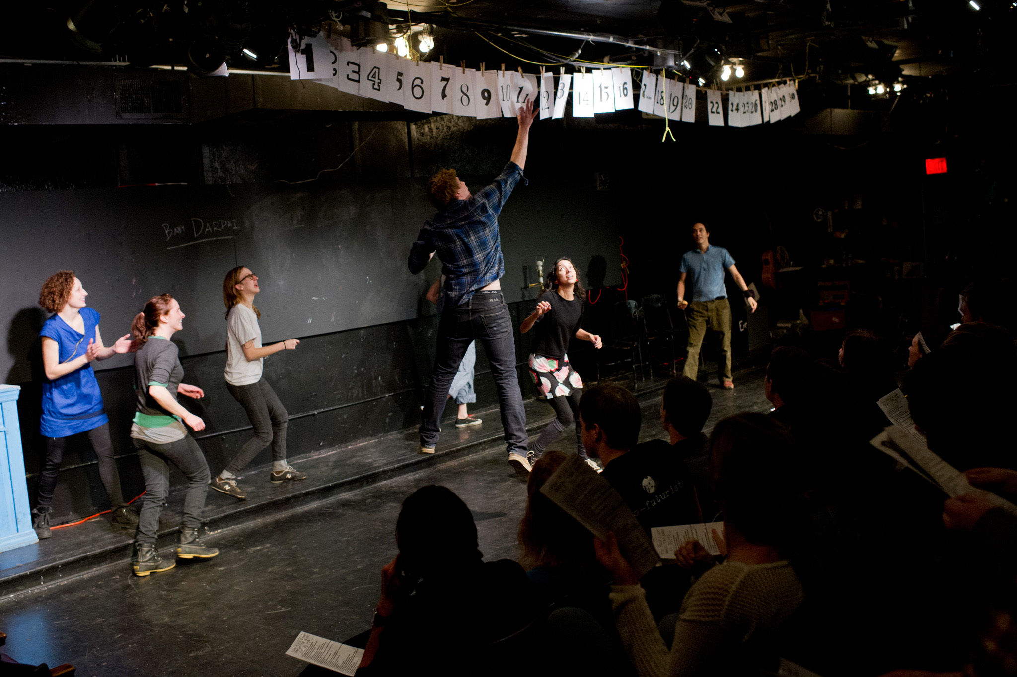 Go to a performance of the Neofuturists' Too Much Light Makes the Baby Go Blind.
