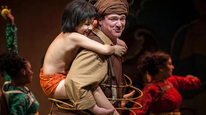 Akash Chopra (Mowgli) and Kevin Carolan (Baloo) in The Jungle Book at Goodman Theatre