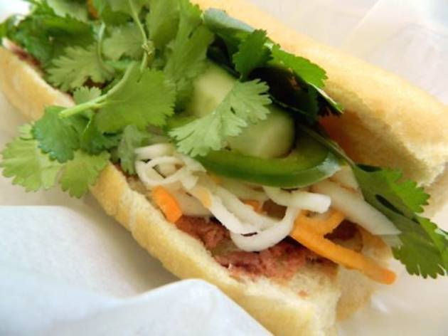 Eat banh mi at Nhu Lan Bakery.