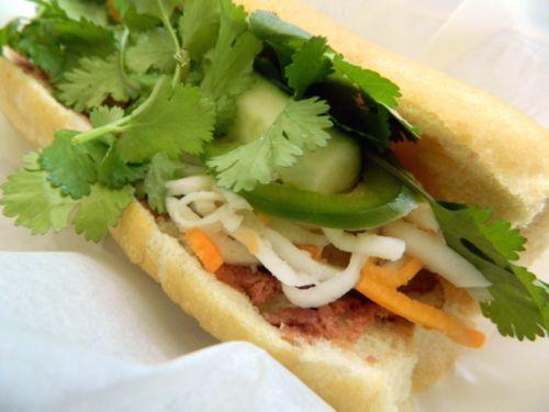 Eat banh mi at Nhu Lan Bakery.