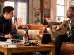Nick (Jake Johnson) talks to Winston (Lamorne Morris) about the cat he's watching in the latest season of New Girl.