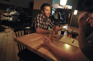 Graham Hogan drinks a cold beverage at Maria's Bar in Bridgeport, Chicago, IL.