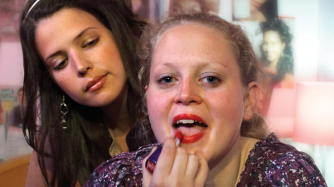 MAKEUP TEST Caroline Neff, right, navigates the lipstick jungle in A Brief History of Helen of Troy.