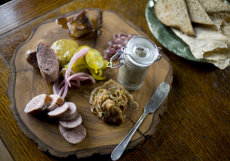 Charcuterie plate with Pork Jowl, Tuscan Salami, Rabbit Liver Pate, Pork Rillette with apple butter, cumberland sausage, Lamb sausage at Owen & Engine, Chicago, IL