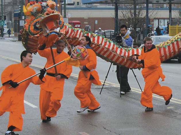 Dragon dancers make their way down the block.