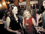 Matchmaker Stefanie Safran, center, introduces Lizzy, left, to a potential date.