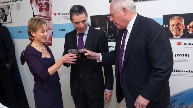 At NATO headquarters, Rule, Rasmussen and Quinn struggle to catch a buzz off of Berghoff root beer, while Emanuel's smiling visage lurks in the background.
