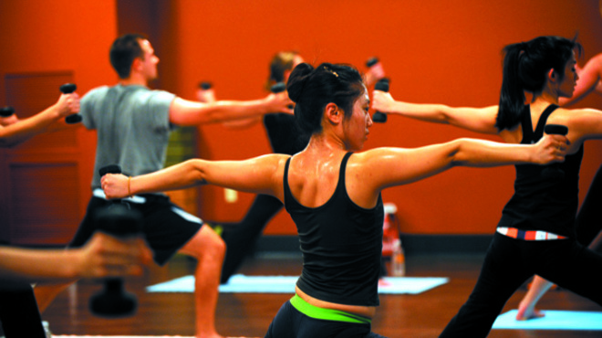Marina Makropoulos | Photographer Chunrui Sun (middle) participates in the Yoga Sculpt class at Core Power Yoga in Chicago on Thursday November 18, 2009.