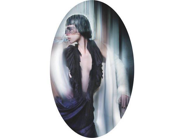 (Hat - Philip Treacy, c. 2004. Coat - Louis Vuitton, A/W 2004. Dress - Wunderkind, S/S 2006. Worn to the film premiere of 'The Phantom of the Opera', 2004 (© Nick Knight))