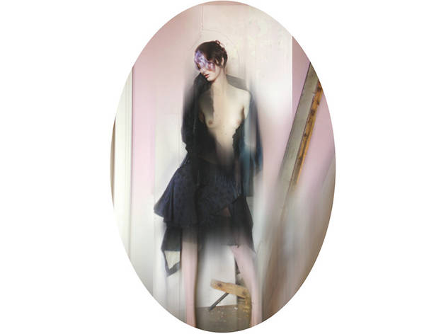 (Black frock coat with feather stand up collar and embroidery detailing, silk and feather (© Nick Knight))