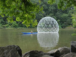A kayak pulls the Harvest Dome