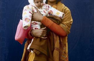 Giles Price ('Kumbh Mela Pilgrim - Mamta Dubey and infant', 2013)