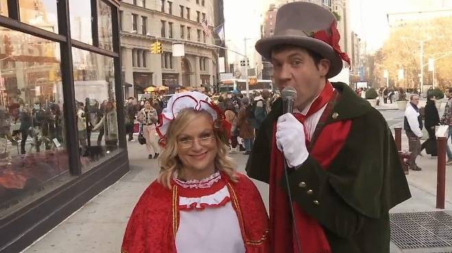 Amy Poehler and Billy Eichner go Christmas caroling in NYC