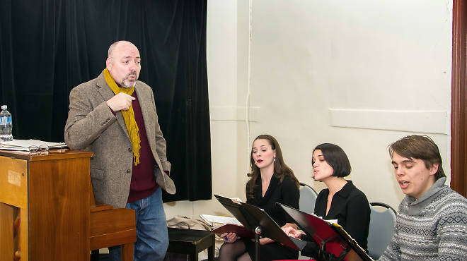 Tom Andolora rehearsing with the Dickens Victorian Carollers
