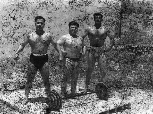 Akram Zaatari ('Bodybuilders, Printed From A Damaged Negative Showing From Left To Right: Hassan El Aakkad, Munir El Dada And Mahmoud El Dimassy In Saida, 1948', 2011)