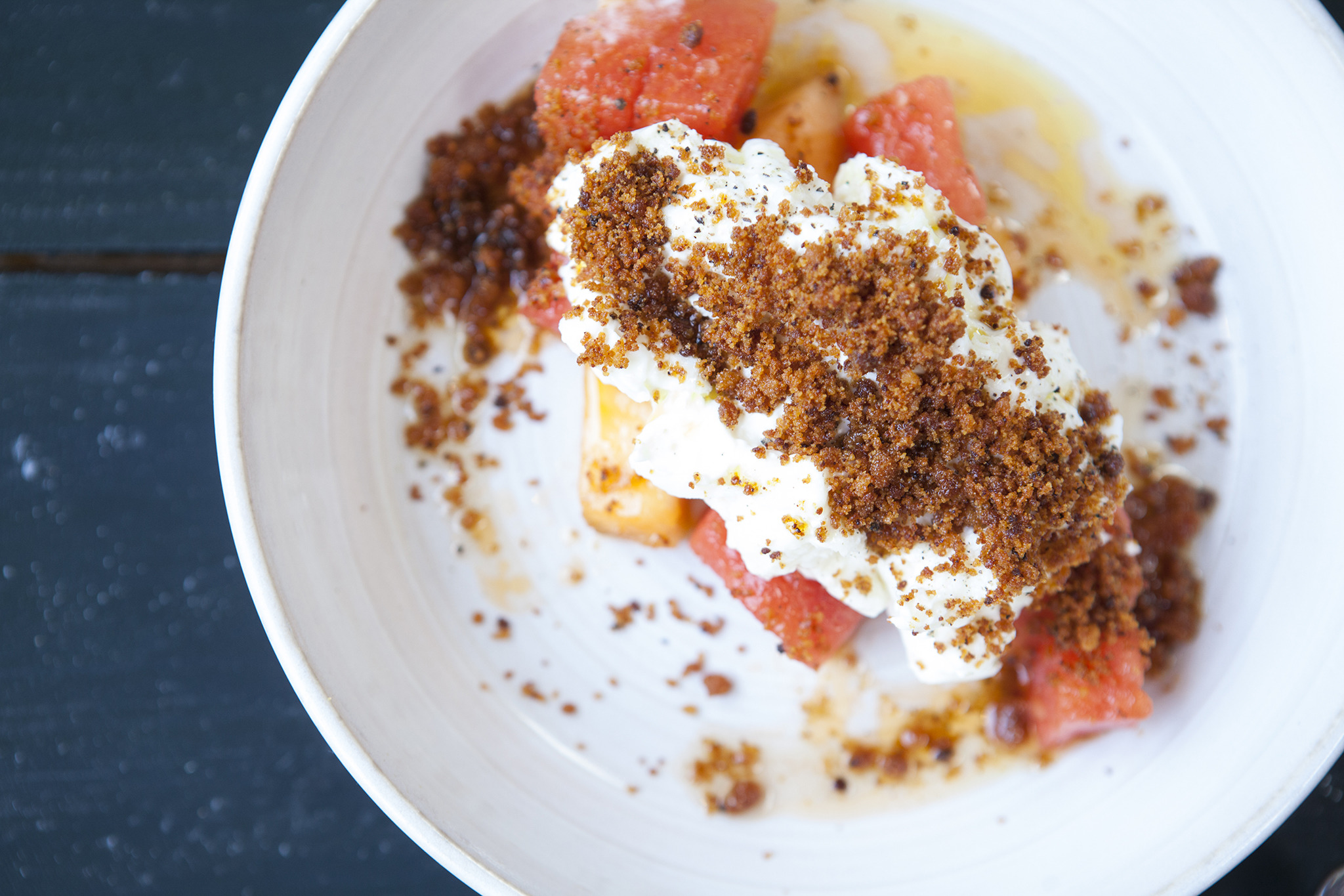 Burrata with Grilled Watermelon and Toasted Milk at Goldie's Burrata is like ooey gooey, buttery mozzarella cheese. Top it on almost anything and it's a no-brainer hit. Thomas Lim rethinks the cheese with grilled watermelon and crunchy toasted milk crumb
