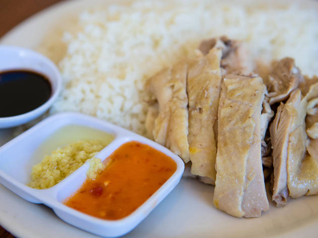 Hainan chicken at Savoy KitchenThere are only a couple of tables at Savoy but if you've managed to squeeze in, order the Hainan chicken rice. It's an all-white-meat poached poultry platter served with three dipping sauces (ginger-scallion, garlic-chili a