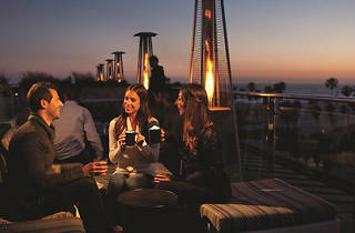 Sunset Romance at High Rooftop Lounge