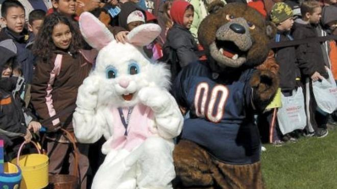 The Easter Bunny and a Chicago Bear forgo cross-species rivalries for a day at the Park District's Egg-stravaganza candy grab.