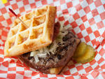 Prime burger on a garlic butter waffle at On the Bun.