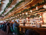 Augie's Booze & Schmooze goes all out for the holiday season by decorating with lights, a model train and more.