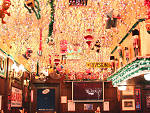 Butch McGuire's decorates for Christmas with mobiles, double-decker model trains and 35,000 lights.