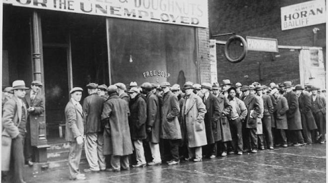Unemployed men queued outside a soup kitchen opened in Chicago by Al Capone in 1931.