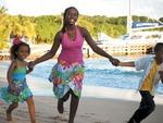 Children play on the beach at Bolongo Bay Beach Resort on St. Thomas.