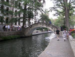 Families stroll the River Walk in downtown San Antonio