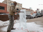 Executive chef Richie Farina sculpts an Ice Luge shot ski in front of Moto Restaurant.