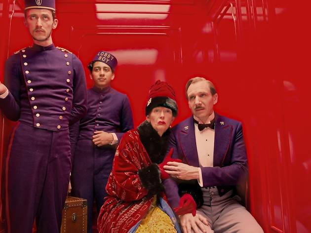 The cast of the Grand Budapest Hotel in a red elevator