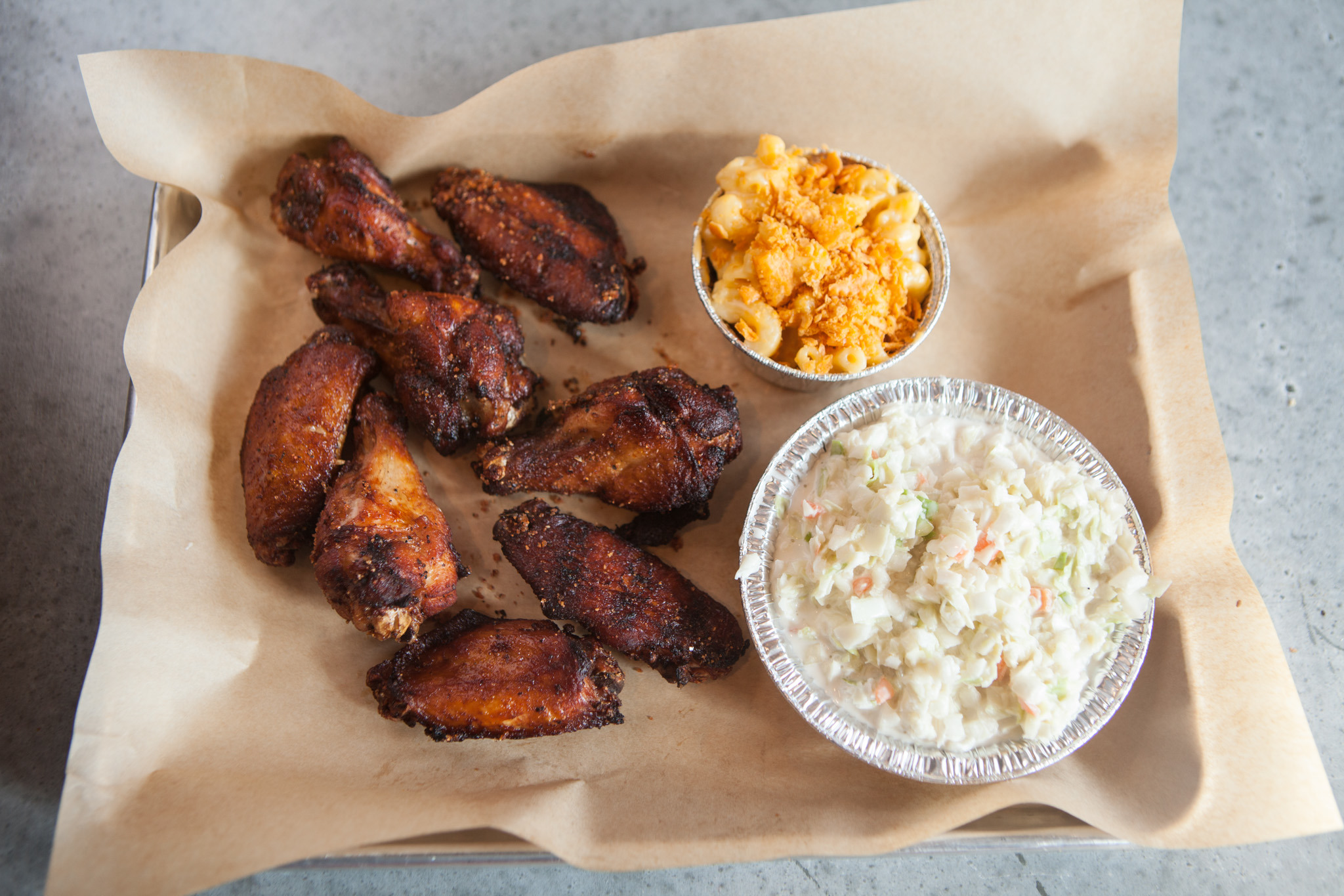 Chicken wings with mac and cheese and coleslaw at Q BBQ.