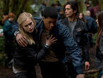 Eliza Taylor as Clarke, Eli Goree as Wells, Bob Morley as Bellamy and Marie Avgeropoulos as Octavia in The 100