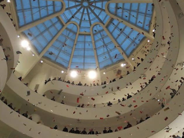 Protest night at the museum: The Guggenheim is disrupted by demonstrators throwing fake money in the rotunda
