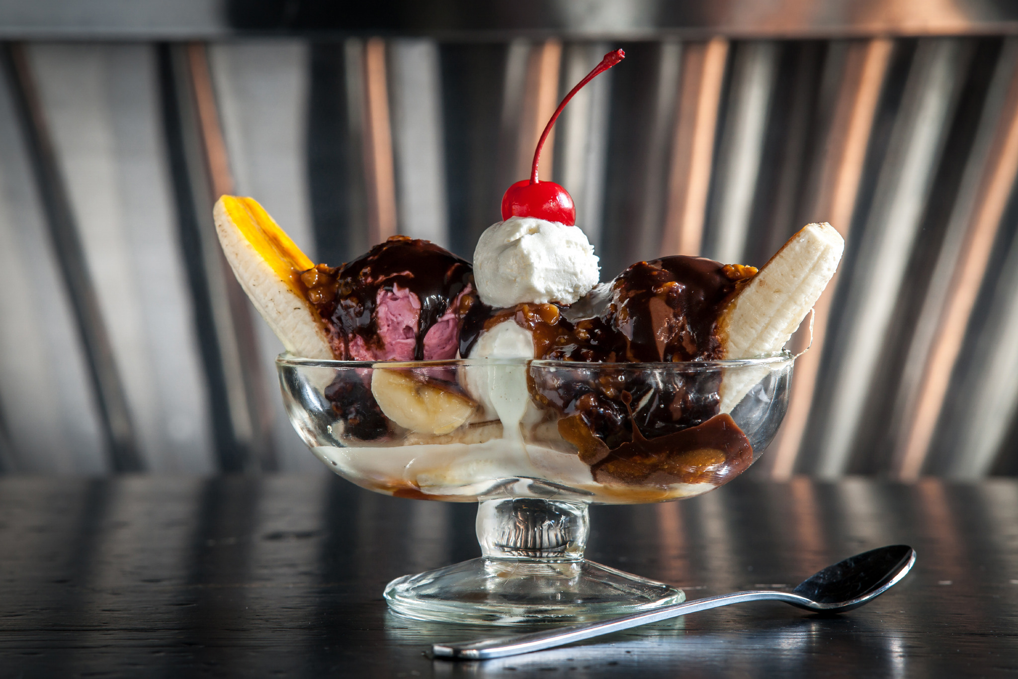 "<h3><a href=""http://www.timeout.com/newyork/restaurants/Empire-Diner"">Banana split at the Empire Diner</a></h3><p>At Food Network star Amanda Freitag's revved-up greasy spoon, three petite mounds of Il Laboratorio del Gelato—vanilla, dark chocolate and seeded raspberry—are covered in upmarket toppings: wet walnuts (simmered in syrup), salted-walnut caramel sauce and sugared banana halves torched until glassy like crème brûlée. And unlike the drippy behemoths found at the ice cream parlor, Freitag's split comes crowned with one tasteful quenelle of whipped cream. But some traditions are sacrosanct: The artful update is finished with a bright neon-red maraschino cherry. <em>210 Tenth Ave between 22nd and 23rd Sts (212-596-7523, <a href=""http://www.empire-diner.com"" target=""_blank"">empire-diner.com</a>). $8. </em></p>"