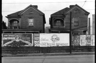 Walker Evans (Atlanta, Georgia. Frame Houses and a Billboard, 1936)