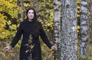 Marina Abramović (Marina in Black coat in the forest)