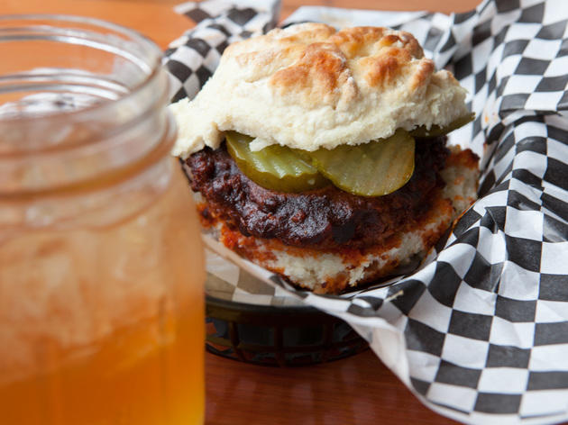 Nashville hot chicken sandwich on a buttermilk biscuit, and an Arnold Palmer at The Roost Carolina kitchen.