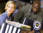 Kathleen Robertson as Hildy Mulligan and Taye Diggs as Terry English in Murder in the First