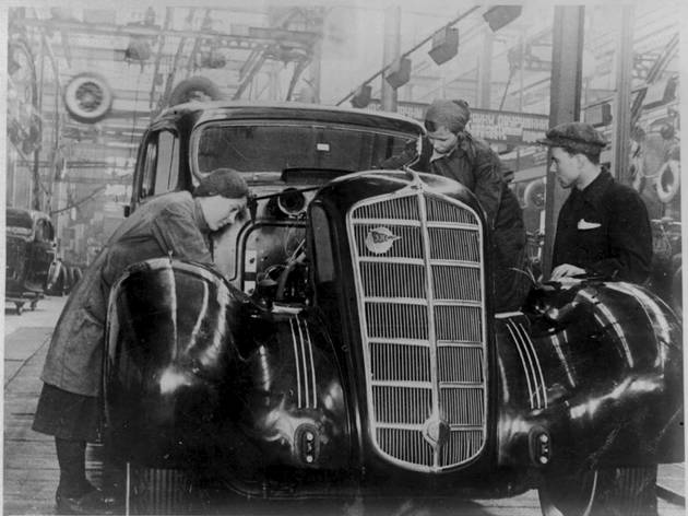 (ZIL workers adding the finishing touches to a limousine, 1940s, Courtesy ZIL and GRAD)