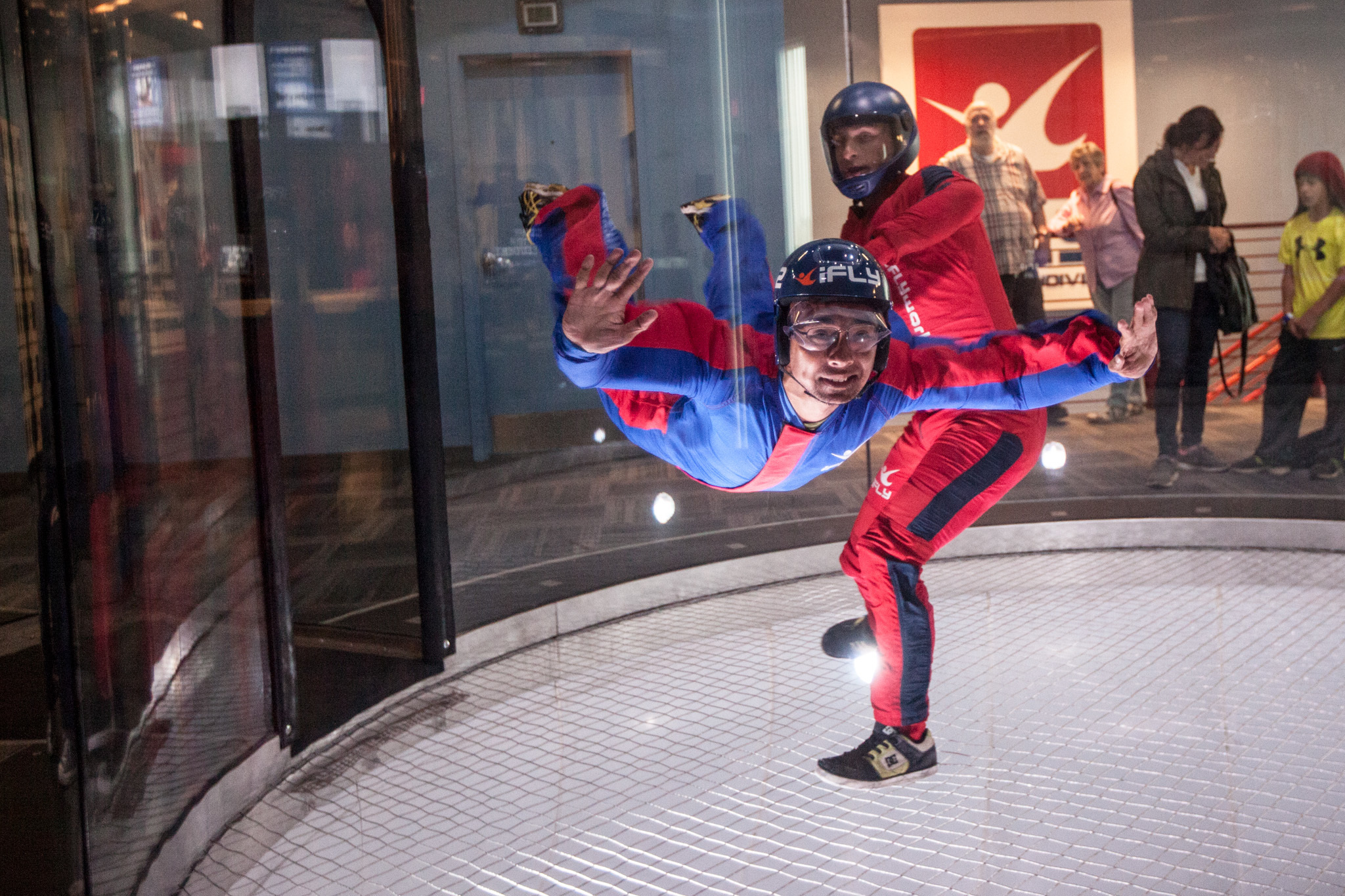 Participants get weightless at the iFly Chicago indoor skydiving vertical wind tunnel.