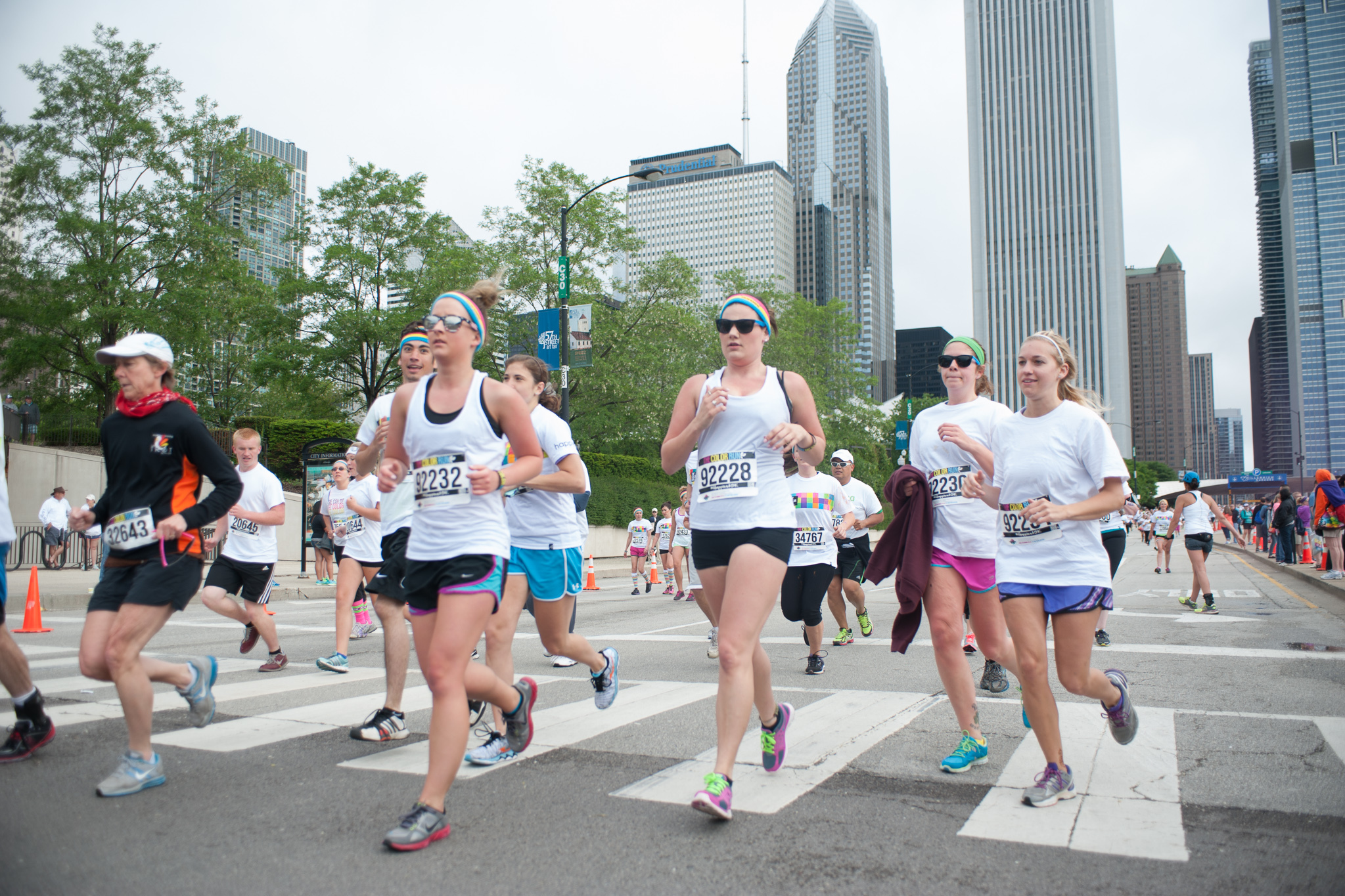 Runners get doused with powdered color at the Color Run 5K through Grant Park on June 8, 2014.