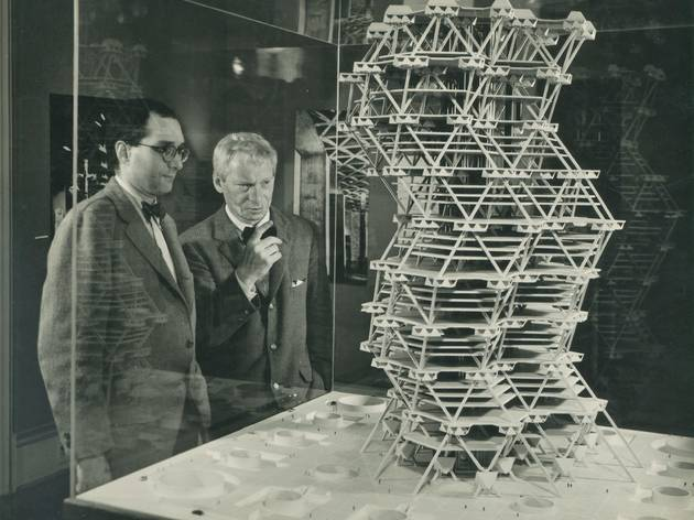 (Louis Kahn in front of a model of the City Tower Project in an exhibition at Cornell University, Ithaca, New York, February 1958 © Sue Ann Kahn)