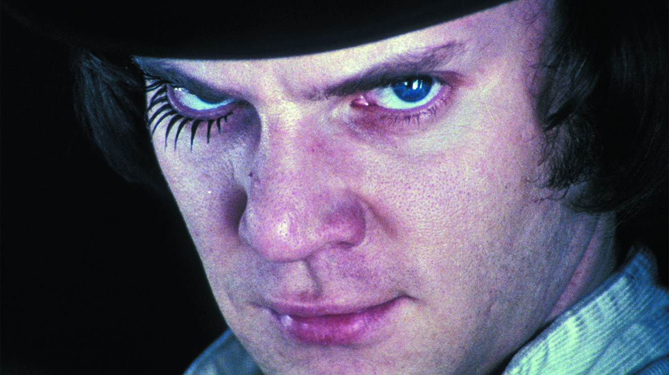 A still from the film A Clockwork Orange of Alex looking into the camera