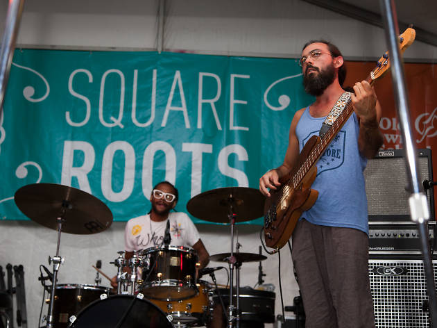 Attendees sip craft beers and enjoy an eclectic music lineup at Square Roots Festival in Lincoln Square, July 13, 2014.