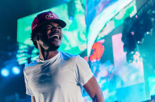 Chance the Rapper hits the stage in Grant Park to play a sold-out Lollapalooza Music Festival 2014.