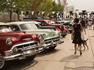 Tricked-out rides cruise into Pilsen for the Slow and Low Community Lowrider Festival, August 10, 2014.